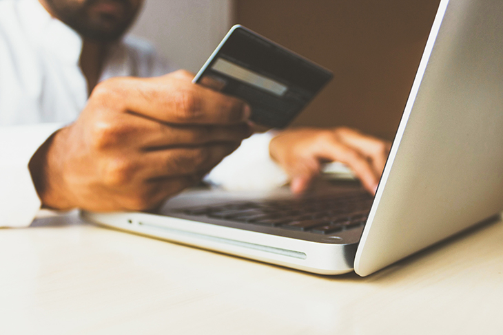 men paying online with credit card