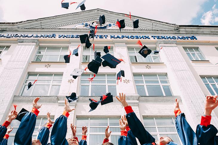 alumni throwing caps