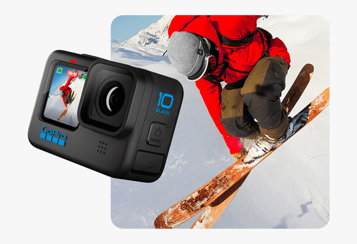 A gopro camera with someone skiing in the snow in the background